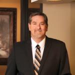 Dr. Larry W Tilger