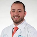 Dr. Alan Pierre Zausner Skarbnik, MD