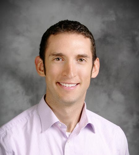 Dr. Adam E Thompson