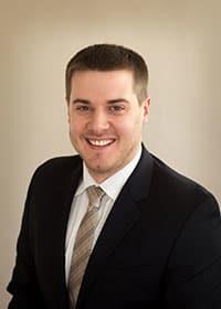 Dr. Andrew J Neuman