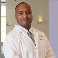 Dr. Langston T Holly MD