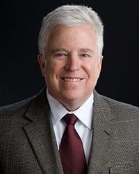 Dr. Mark E Maunder MD