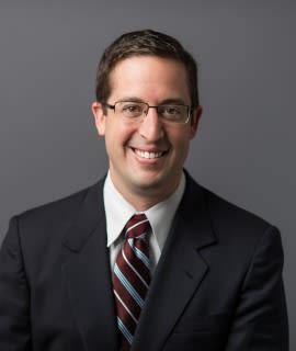 Dr. Mathew E Levine
