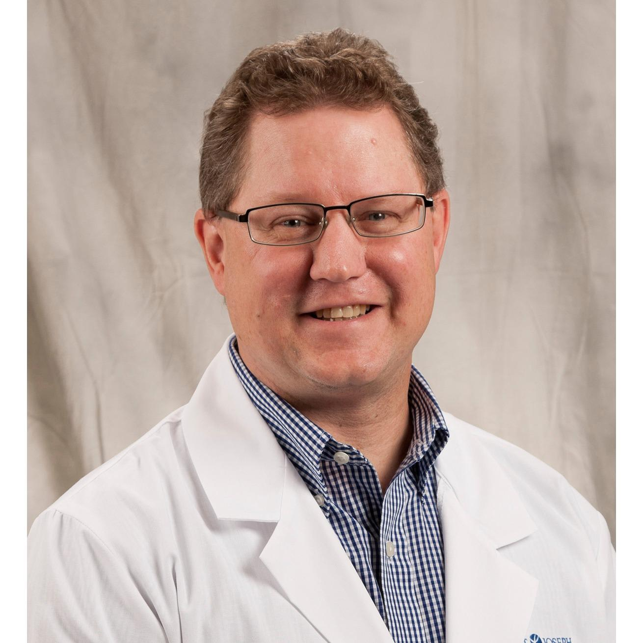 Dr. Gregory E Buck MD